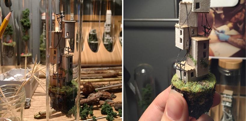 Sculptures miniatures de maisons sur du bois